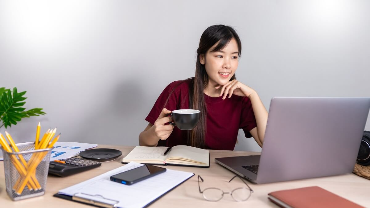 A young, beautiful relaxing business asian girl use a laptop wor